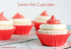 This Santa Hat Cupcakes Recipe is made with a doctored up cake mix, buttercream icing, and white sugar pearls. This doctored up cake mix recipe is the BEST! Cupcake Icing, Buttercream Icing, Cake Mix Recipes, Cupcake Recipes, White Food Coloring, White Cake Mixes, Creamed Eggs, Christmas Cupcakes, Santa Hat