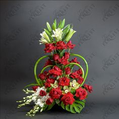 A Lexis Florist signature design, this design features a double heart made of calla-lilies. Flowers in this arrangement include roses, dandrobium orchids, cymbidium orchids and white lilies. This is the ultimate romance flower arrangement.