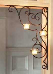 These elegant brackets look lovely in the corner of a doorway or window, plus romantic scrolls and flickering candlelight add ambience to your decorating. Three votive cups on each bracket provide the perfect mood lighting. Wrought Iron Decor, Home And Deco, Metal Art, Candle Sconces, Living Room Decor, Dining Room, Diy Home Decor, Candle Holders, Interior Decorating