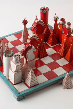 Terracotta Chess Set. Orange & Blue (my favorite). Only $1200 at Anthropologie. Hah.