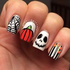 Try pumpkin nail art this Halloween for a festive touch to your manicure.