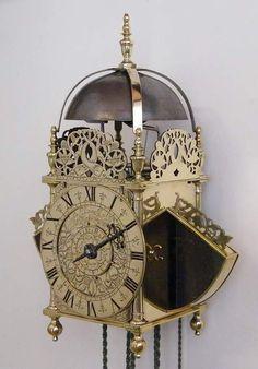 17th century English winged brass lanternclock, signed John Ebsworth at the Cross Keys in Lothbury Londini Fecit.