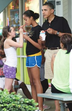 Barack Obama, Malia Obama  FILE - In this Dec. 27, 2010 file photo, President Barack Obama, right, his daughter Malia, second from right, and family and friends eat Shave Ice at Island Snow at Kailua Beach Center while on vacation with the first family in Kailua, Hawaii. (AP Photo/Carolyn Kaster, File)   Carolyn Kaster,   FEB 25, 2011