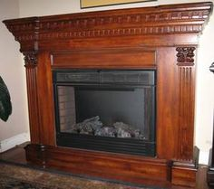 Needs to be painted white - $750.00 BEAUTIFULLY CARVED OAK ELECTRIC FIREPLACE & MANTEL