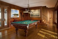 This looks so relaxing! I love the woodwork, the light coming through the shutters on the doors...and look at the pool table itself! Beautiful.
