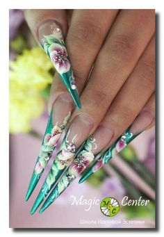 Flowers Stiletto nail art. Love the design but not the shape of the nails, I'm not into the stiletto style
