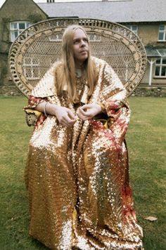 1970s, England, UK --- Rick Wakeman, keyboardist for the band Yes, sits in a wicker chair in front of his home in England.