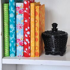 This was my thought for shelves  Scrapbook paper covered books