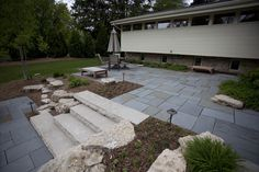 Terraced bluestone patio with limestone steps.