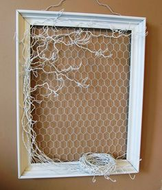 Wire jewelry tree in frame = chicken wire in frame with similar color wire to make tree and a nest
