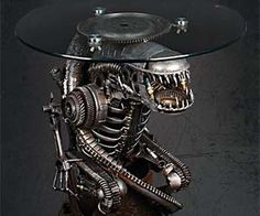 Decorate your home movie theatre room in glorious Xenomorph-like fashion with this Alien coffee table. Handcrafted using recycled motorcycle and car parts, this unique piece of furniture is an excellent gift idea for an Aliens movie fan and/or collector.