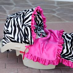 Luxury blankets and car seat covers... Gonna need something other than animal print