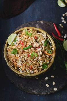 This salad is full of crunch from raw papaya, bean sprouts and peanuts and the spicy soy based dressing adds a perfect spike to it.