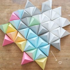 """paper pyramids -with a piece of tissue paper glued along the last seam that says """"take me"""" or """"open me"""" these would be perfect"""
