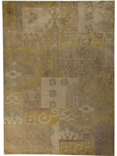 Sarangi - Beige is a hand tufted, hand-stitched rug that is made of 100% wool. This rug embodies the concept of recycling. It is not made of new yarn, but  made using the left over yarn from other rugs that has been re-dyed/over-dyed. Made in India.