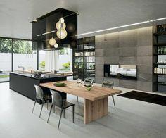 cuisine équipée avec ilot central, ilot et table dans une grande cusine
