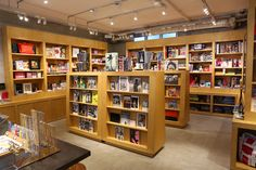 BOOKMARC Bookstore Design, Vinyl Store, Store Image, Book Cafe, Toy Store, Liquor Cabinet, Harajuku, Retail Displays, Shelves