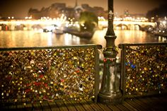 Love Lock Bridge in Paris, France. Write your names on the lock, toss the key.