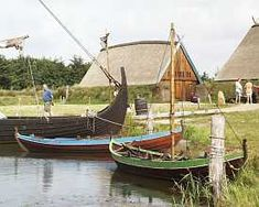 Bork Viking Harbour with reproduction houses and Viking ship.  Photograph by the Ringkøbing- Skjern Museum.