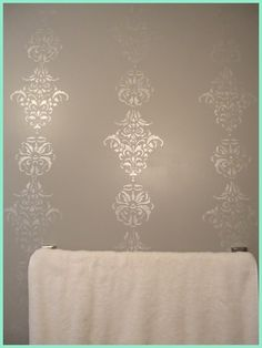 doing this but with soft pink walls, but def the pearlized paint for stencil, on the crib wall