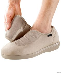 Women's Indoor/Outdoor Neoprene Shoe Slippers stretch to fit foot comfortably. Terrific for swelling feet. Ultra-lightweight adaptive shoe and/or slipper. The Extra-Wide and Extra Deep opening closes with an adjustable VELCRO® brand strap and makes this the best choice for diabetic feet and edema in feet. This neoprene shoe features removable, cushioned insoles accommodate orthotic inserts. Machine washable footwear. Great VELCRO® shoes / slippers for swollen feet. Comfor...