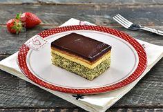 Prajitura Tosca este o prajitura delicioasa compusa dintr-un blat de pandispan cu mac, o crema de vanilie, un strat de biscuiti si glazura de ciocolata.