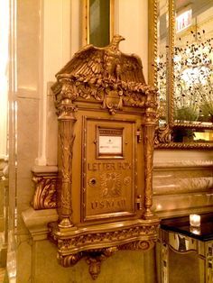 The St. Regis still operates one of the most luxurious lobby box, decorated with the Federal Eagle motif. (Photo: Luke Spencer). NYC mail chutes.