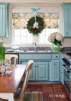 love the teal/turquoise cabinets with silver knobs. Gray countertop makes pop. Color paint = Sherwin Williams--Spearmint