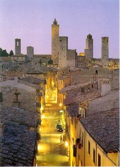 San Gimignano, Italy. Often called Tuscany's Manhattan as the towers on a number of the buildings look like the Manhattan skyline as you approach. Home of Vernaccia wine unique to the area and dating back to the 1200s; a longstanding favourite of the popes and a great summer libation. Province of Siena , Tuscany region Italy