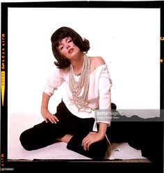 American actress Marilyn Monroe (1926 - 1962) wearing a black wig, Beverly Hills, California, July 1962. The two sessions for the photoshoot took place in late June and early July, only weeks before her death on 5th August 1962. The images were published posthumously in Vogue magazine under the title 'The Last Sitting'.
