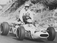 French GP, 1965: Innes Ireland and Jo Bonnier hitch a ride back to the pits on Ritchie Ginthers Honda.