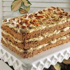 Mocha Angel Loaf This low-fat chocolate three-layer cake recipe is baked in a single layer baking pan then cut in rectangles and stacked. It is layered with creamy coffee-flavor filling and topped with pretty chocolate curls.