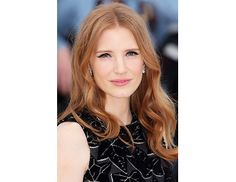 @Byrdie Beauty - Jessica Chastain    Chastain is stunning with simple winged liner, a glossy lip, and loose waves.