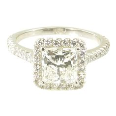 Tiffany & Co. Diamond Platinum Princess Cut Engagement Ring | From a unique collection of vintage engagement rings at https://www.1stdibs.com/jewelry/rings/engagement-rings/