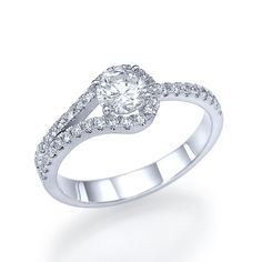 Anna - Round Engagement Ring in 14k White Gold (.86 ct t.w) - 14k white gold round diamond side stone engagement ring including a .51 carat center diamond embellished within a four-sprong setting and thirty-six side diamonds (.35 ct t.w).