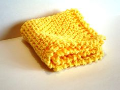 Bright Sunny Yellow DishCloth  Made of 100% cotton, this hand-knit cloth measures approximately 8 x 8 (20cm x 20cm) and will stretch when wet. Wash / dry with other like items.  Excellent for use as a dishcloth, facecloth or washcloth.   Please visit my shop ennadoolf.etsy.com for more handmade gifts.  Thank you.