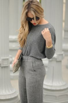 Love the grey on grey, but I would wear a beige patent leather belt & clutch to match the hair.