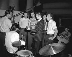 "1956 Rehearsing ""Don't Be Cruel"" Bill Black, DJ Fontana, Hugh Jarrett, Neal Matthews, Elvis, Gordon Stoker, Hoyt Hawkins and Scotty Moore"