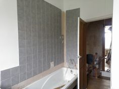 15.)  I am aware this is like spot the difference! But the shower wall is done...