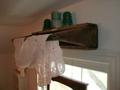 Primitive tool tote turnedsideways and screwed to the wall over the window. ~ LOVE this idea for a window treatment!