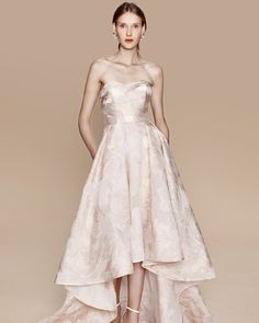 Blush strapless fil coupé gown with draped bodice and high-low skirt and horsehair detail