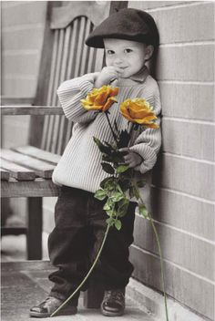 Stunning colourlight Maxi poster featuring a young chap clutching some colourful flowers, waiting for his belle to arrive. Kim Anderson First rendezvous Maxi Poster
