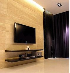 Love the sleek shelves, the wall mounted TV, and how do they do the lighting? Its like its coming from the ceiling!