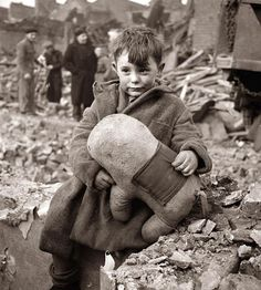 1940 an abandoned boy clutching stuffed animal following German aerial bombing of London