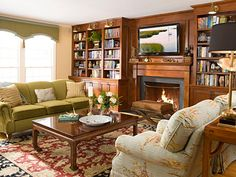 """Designer Cynthia Mason says that the blue and green combo she's partial to """"can be traditional or go all the way modern."""" She opted for the traditional version in this family room, accenting an apple green sofa with a light blue throw and matching trim on the custom window cornices. """"The blue and green work together because they are analogous colors of similar intensity,"""" she says. For a more modern feel, deepen the intensity to kelly green and navy, such as Farrow & Ball's Hague Blue…"""