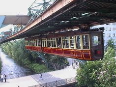 "The Wuppertal ""kaiserwagen"" which once carried the German Emperor. Opened in 1903, this suspended monorail is one of the safest modes of transportation!"