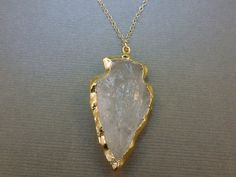 Clear Arrowhead layered in 24k Gold - Arrowhead Necklace - 14k gold fill chain - Arrowhead pendant by Magicloot on Etsy https://www.etsy.com/listing/104956099/clear-arrowhead-layered-in-24k-gold