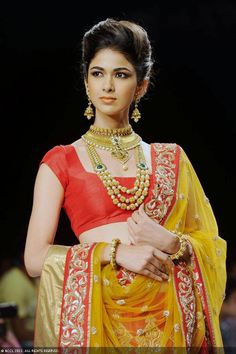 A model walks the ramp to showcase a creation by jewellery brand Laxmi Jewels during the India International Jewellery Week (IIJW), held at Grand Hyatt, Mumbai, on August 07, 2013