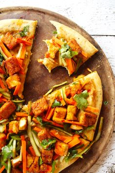 Banh Mi Pizza Recipe - Port and Fin - Classic flavors of a Bánh Mì sandwich, but on a pizza! Fluffy dough, a hoisin-based sauce, pickled veggies, and crisp, spicy fried tofu.