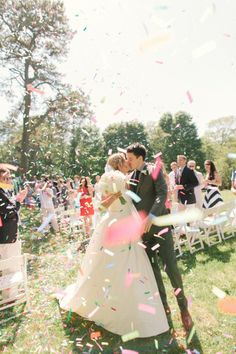 Mr and Mrs. and a cloud of #confetti  Photography by rutheileenphotography.com  Read more - http://www.stylemepretty.com/2013/10/01/cape-cod-wedding-from-ruth-eileen-photography/
